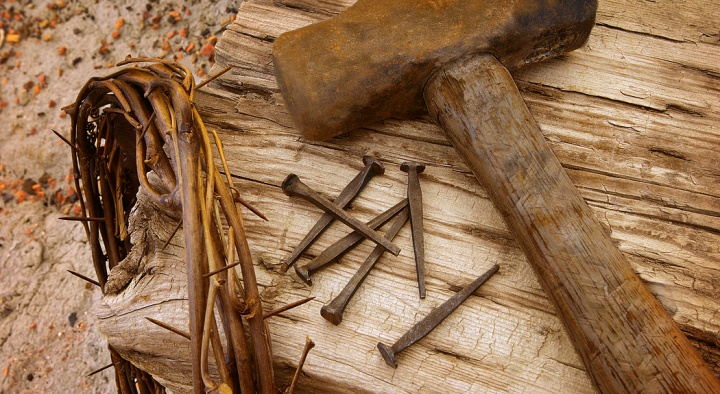 Crown of thorns, old nails and old hammer.