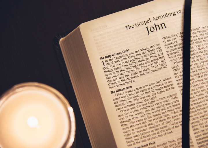 A Bible opened to the book John.