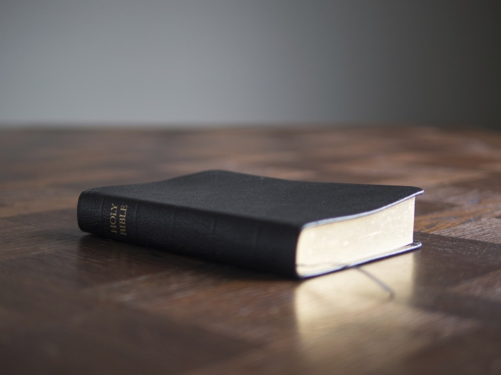 Bible laying on top of a table.