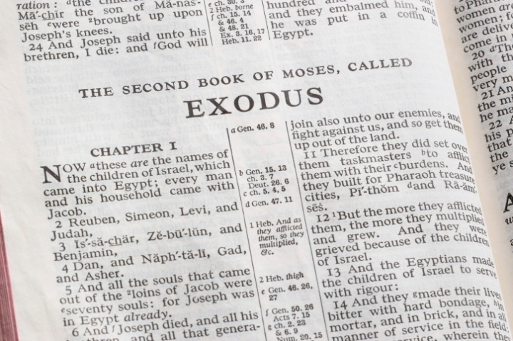 A Bible opened to the book of Exodus.