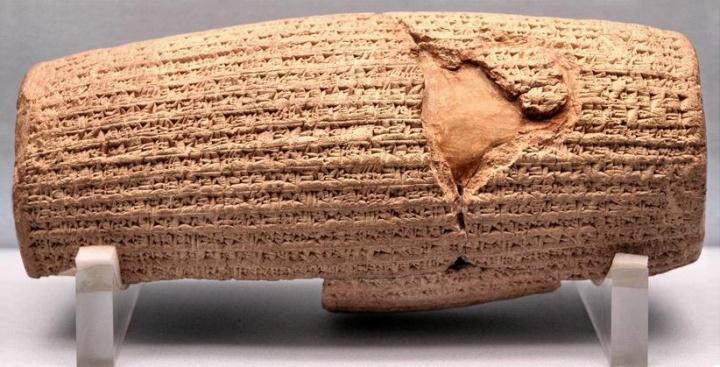 A cuneiform-covered cylinder.
