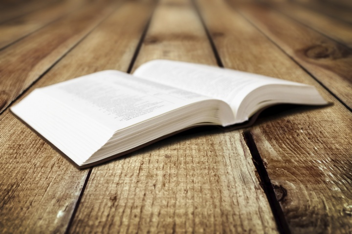 An open Bible laying on a table.