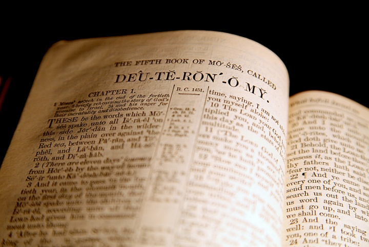 A Bible opened to the Book of Deuteronomy.