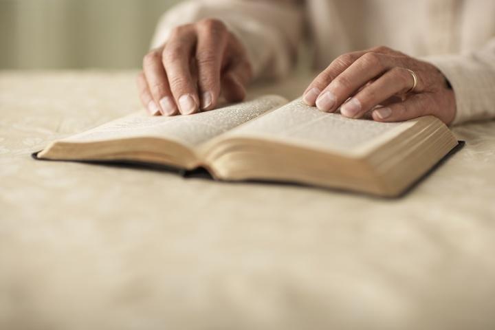 A woman reading a Bible.