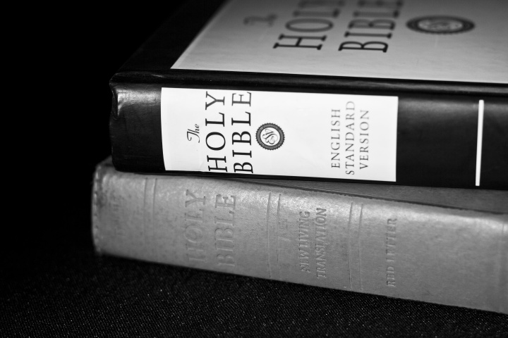 Bibles stacked on top of each other.