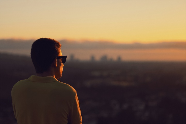 A man looking at a sunrise.
