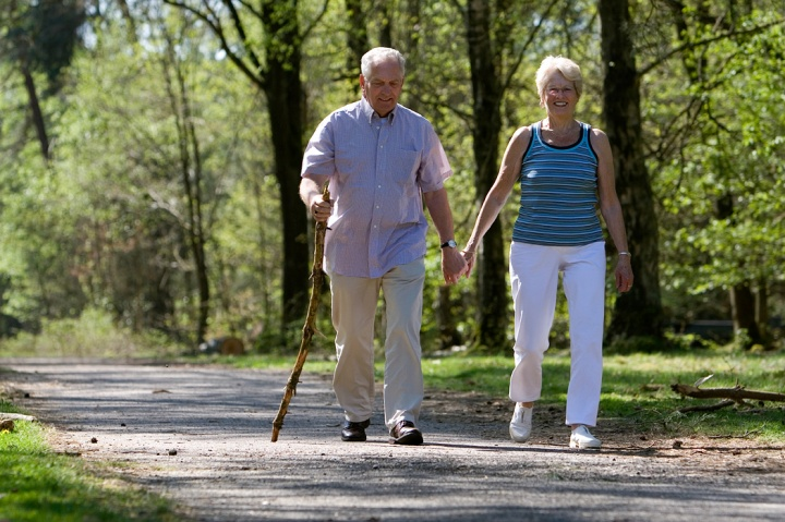 An elderly couple walking together.