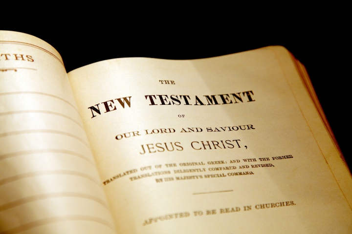 A Bible opened to the beginning of the New Testament.