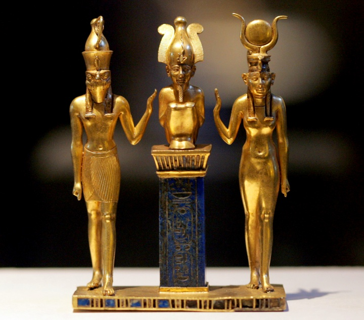Gold figurines of Egyptian gods Osiris, Horus and Isis