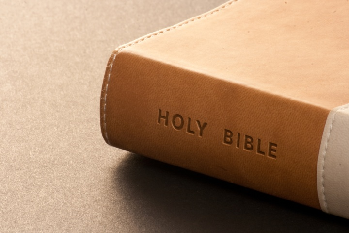 A leather Bible on a table.