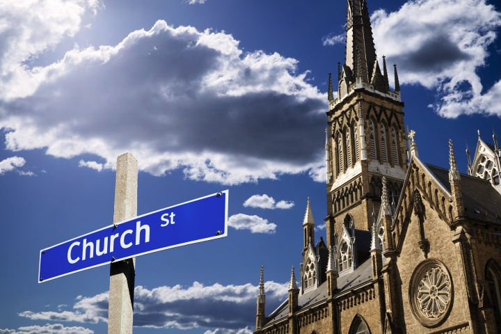 """A church building with a street sign in front that says """"Church Street"""""""
