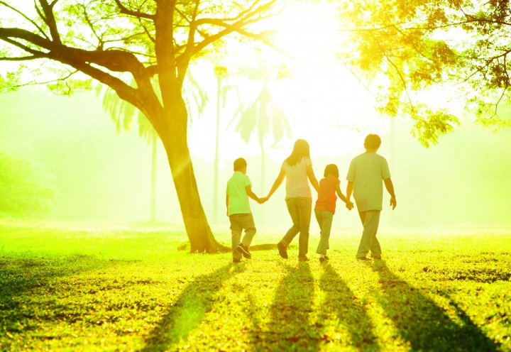 A family walking together outside.