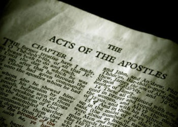 Page of the Bible opened to Acts.