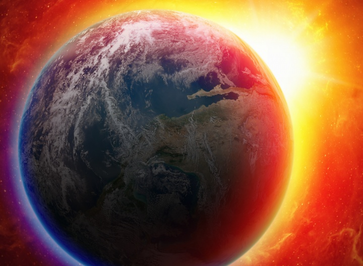 The earth from space with a red/orange glow in the background.