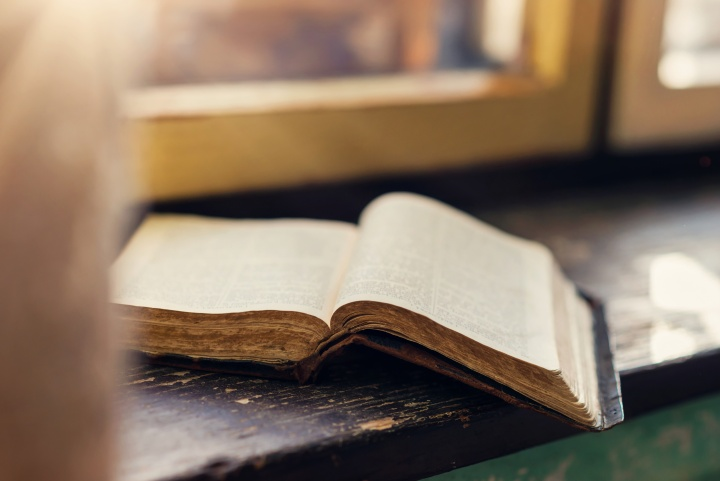 An open Bible on a windowsill.