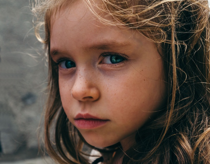 A young girl looking sad.