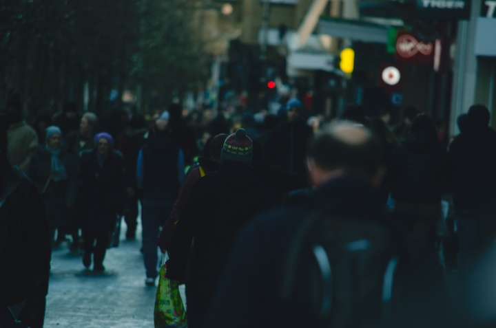 People walking on a crowded city street.