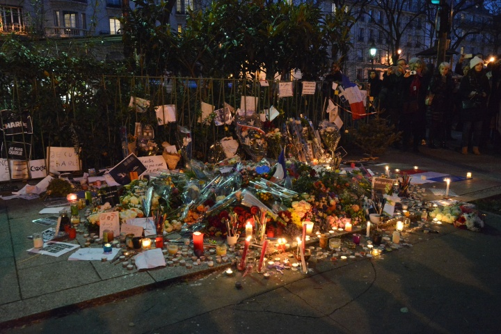 A memorial of candles to recent victim of terrorist act.