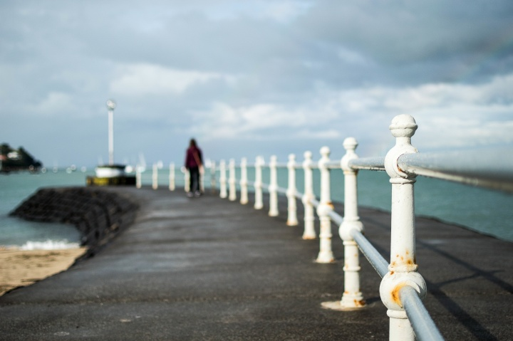 A person walking on an pier.