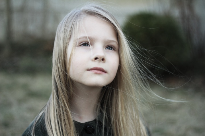 A young girl looking up.