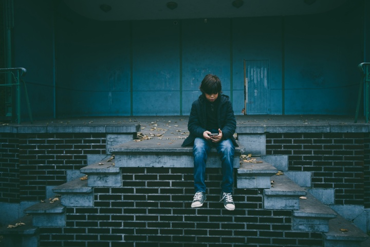 A young boy using a mobile device.