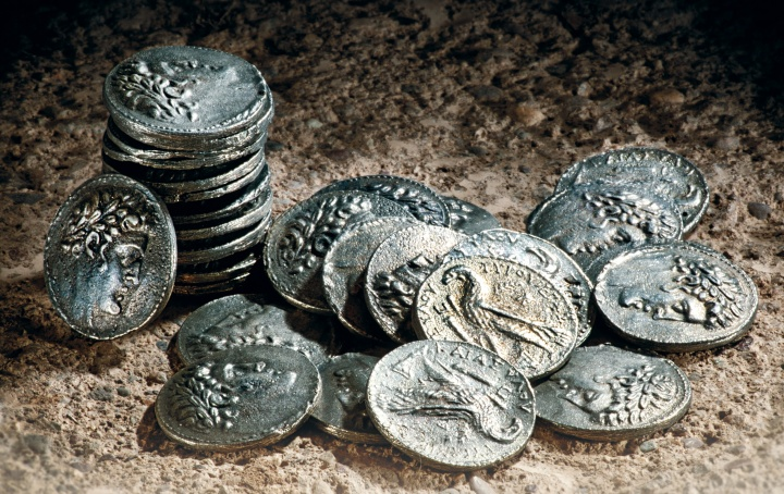 A photo illustration of pieces of silver coins.