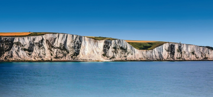 The White Cliffs of Dover are cliffs that form part of the English coastline facing the Strait of Dover and France.