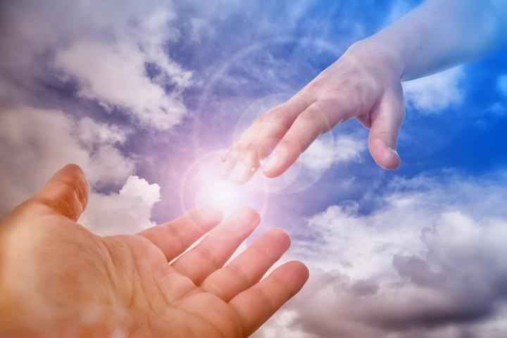A photo illustration of hand coming out of the clouds.