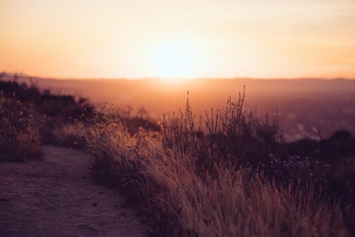A sunset over a hill.