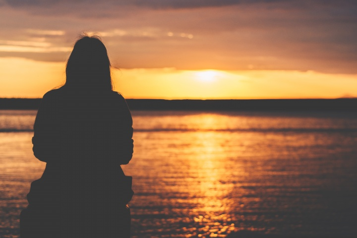 A person watching a sunset.