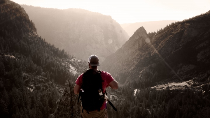 A man hiking on a mountain trail.