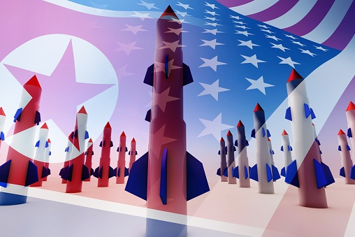 Photo illustration of missiles, the North Korean flag and the United States flag.