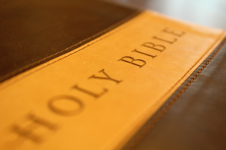 "A Bible with ""Holy Bible"" on a leather cover."