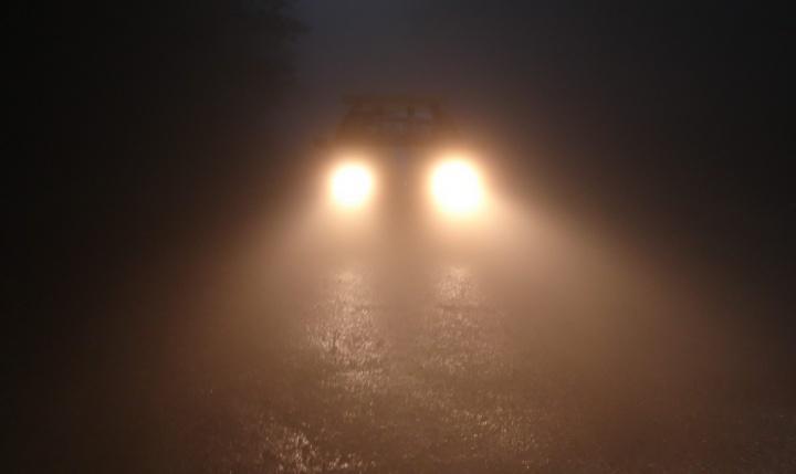 Bright car headlights in the dark.