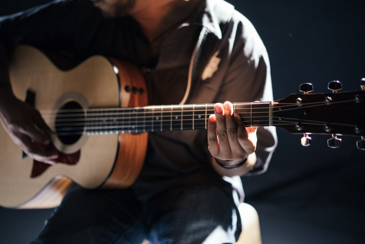 A person playing a guitar.