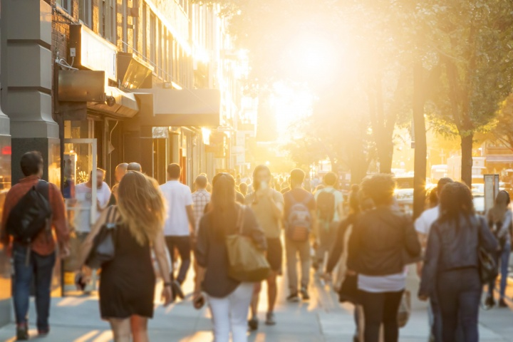People walking on a sidewalk.