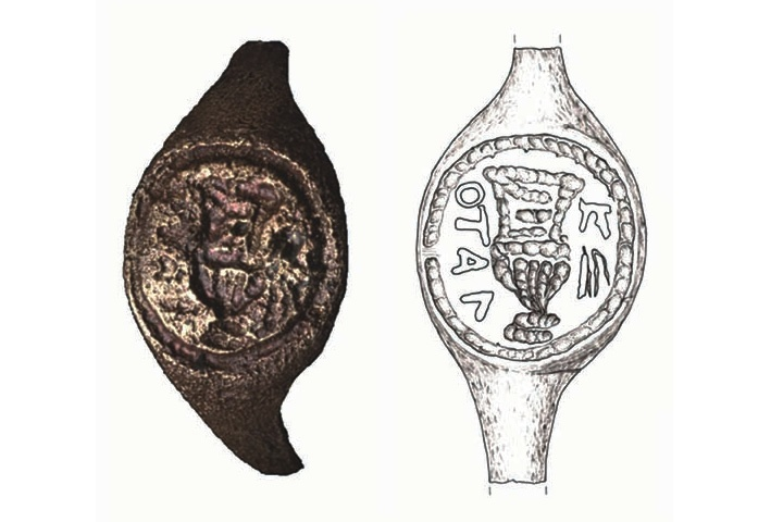 "When thoroughly cleaned for the first time, this ring was found to bear a Greek translation of the Latin name ""Pilate"" on either side of a a large wine vessel known as a krater."