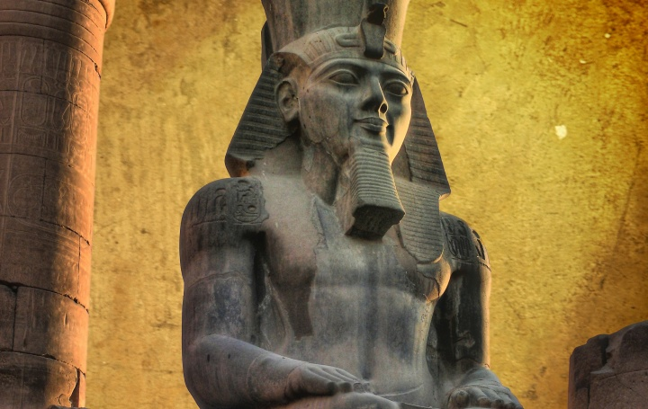 Colossus of Ramses II (made in black granite) in the Luxor Temple (Egypt)