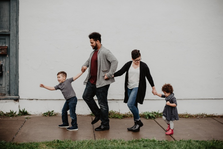 A family walking down a sidewalk.