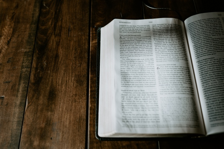 A Bible opened to the book of Romans