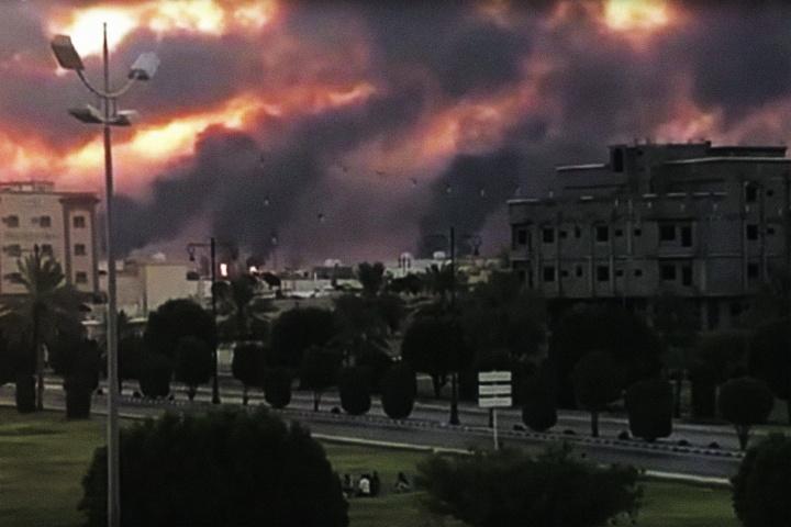 A Saudi oil facility burns after an Iranian attack.