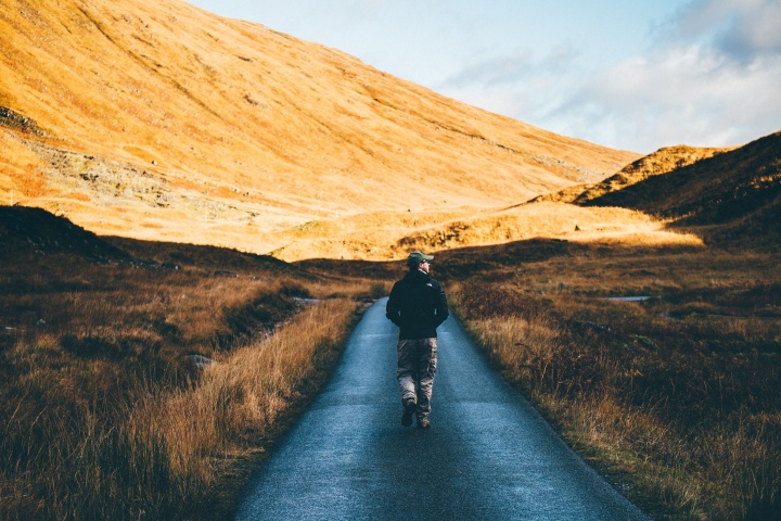 A man walking on a path.