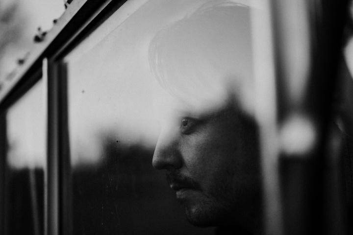 A man looking through a window.