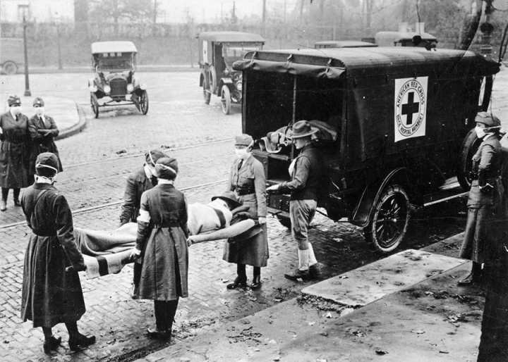 Nurses transport a Spanish flu victim in 1918.