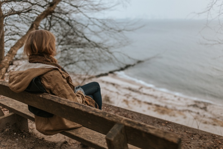A woman sitting on a bench.