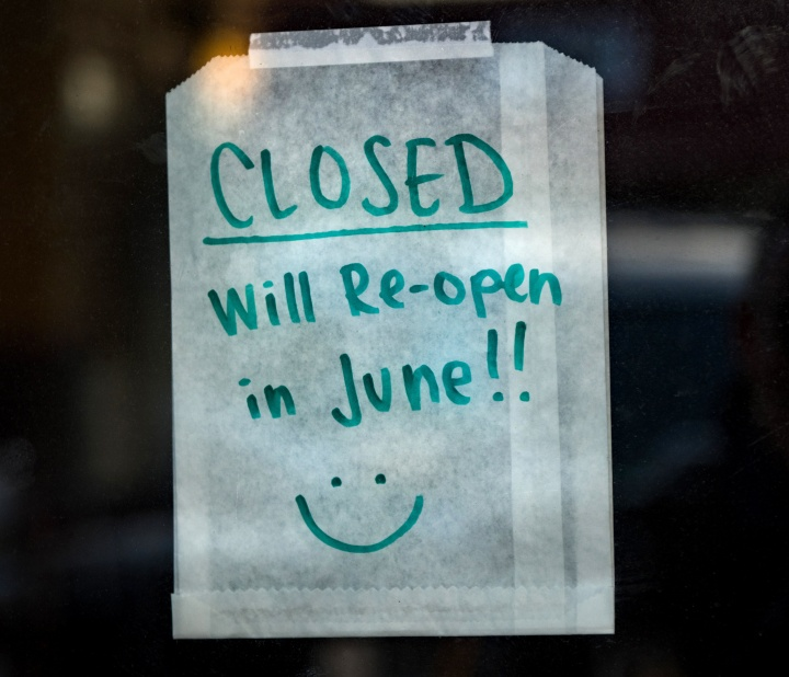 A handwritten note on business store door that its closed till June.