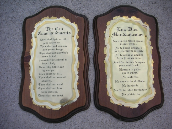 Photo of two plaques with the Ten Commandments written on them in English and Spanish.