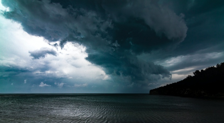 Photo of storm clouds over the ocean.