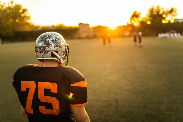 Football player on field at sunset