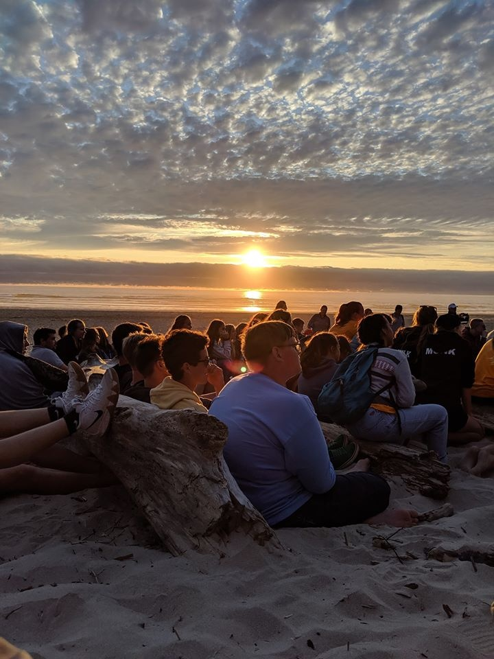 Sunset over a group of campers on the coast